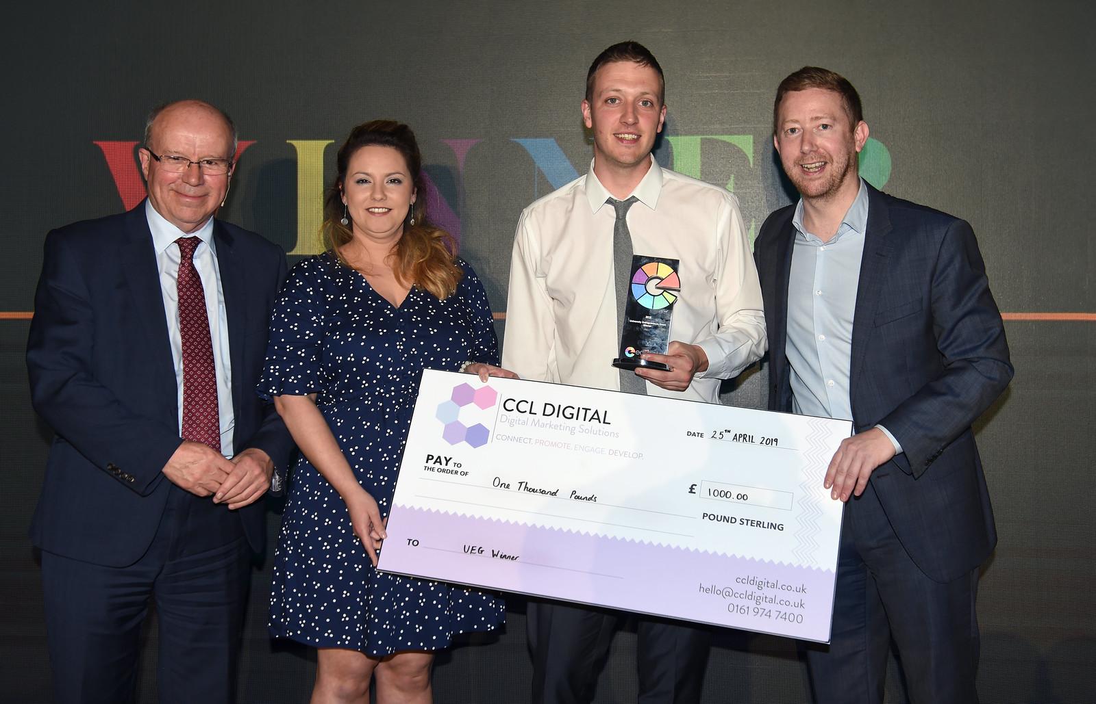 Dave Clayton winning a cheque